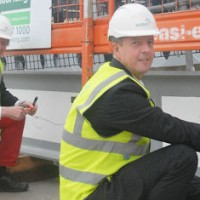 Nick Boles signing a construction beam of 2 Glass Wharf, Bristol