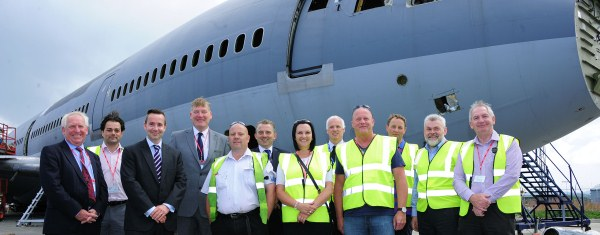 Kris Hopkins (4th from L) meets local people employed at Newquay Aerohub