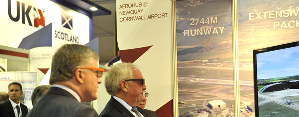 Business Minister, Mark Prisk and Chris Pomfret, Chairman of the Cornwall & Isles of Scilly Local Enterprise Partnership, watching a video of the Aerohub wearing 3D glasses